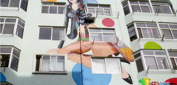 Paintings of fashion beauties on resident buildings
